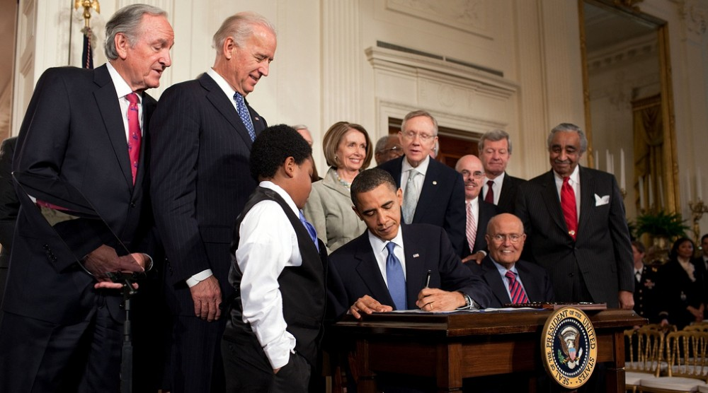 President Obama Sings the Affordable Care Act Into Law